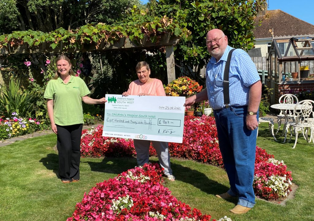 Alan and Jenny King, pictured with CHSW area fundraiser Henrietta Olsson, raised £867 for Children's Hospice South West in memory of their grandson Stanley. Picture: CHSW