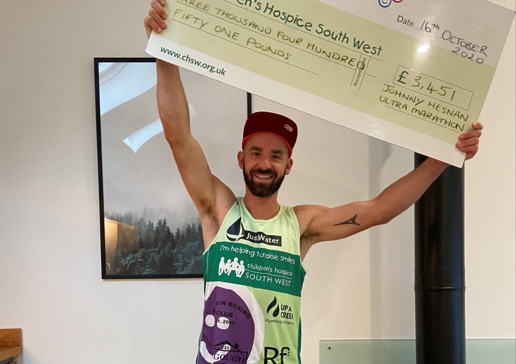 Johnny Hesnan with his donation for Children's Hospice South West