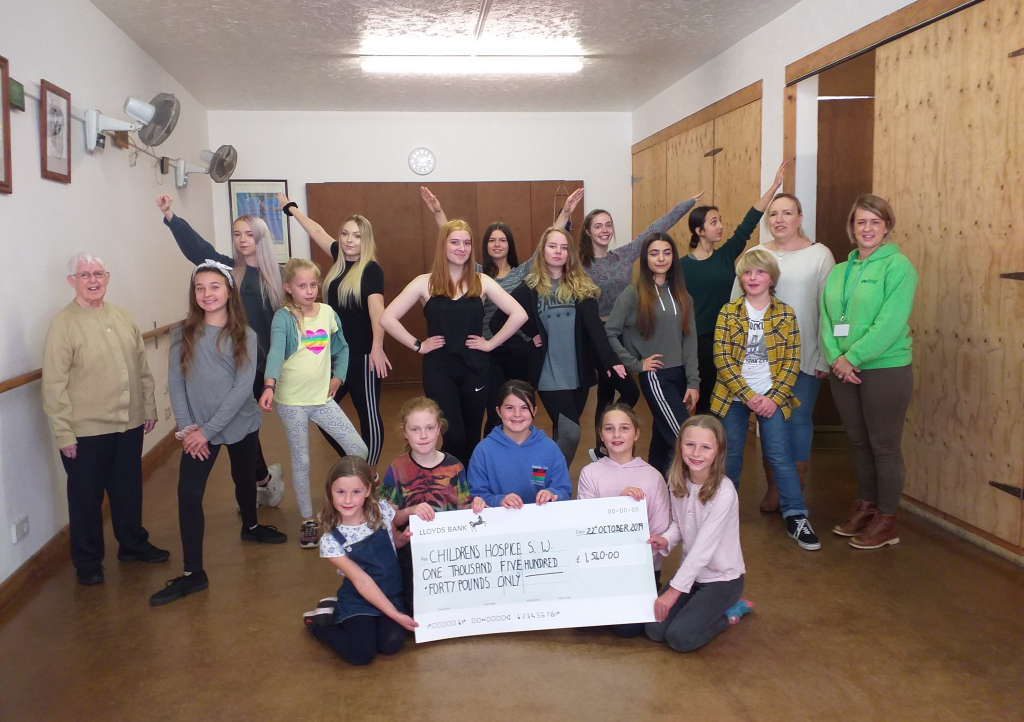 June Bealey (left) and Lisa-Jayne Flynn and Children's Hospice South West Community Fundraiser Laura Robertson (right) with students from the June Bealey School of Dance