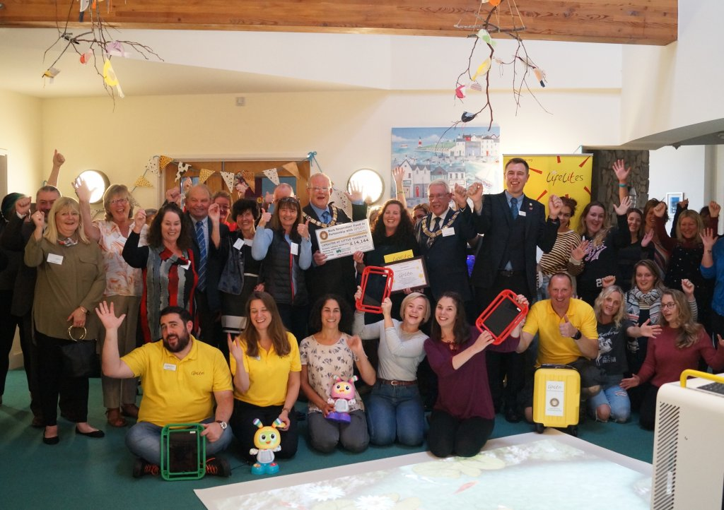Little Harbour care staff and Lifelites team celebrate the donation of new equipment for Little Harbour