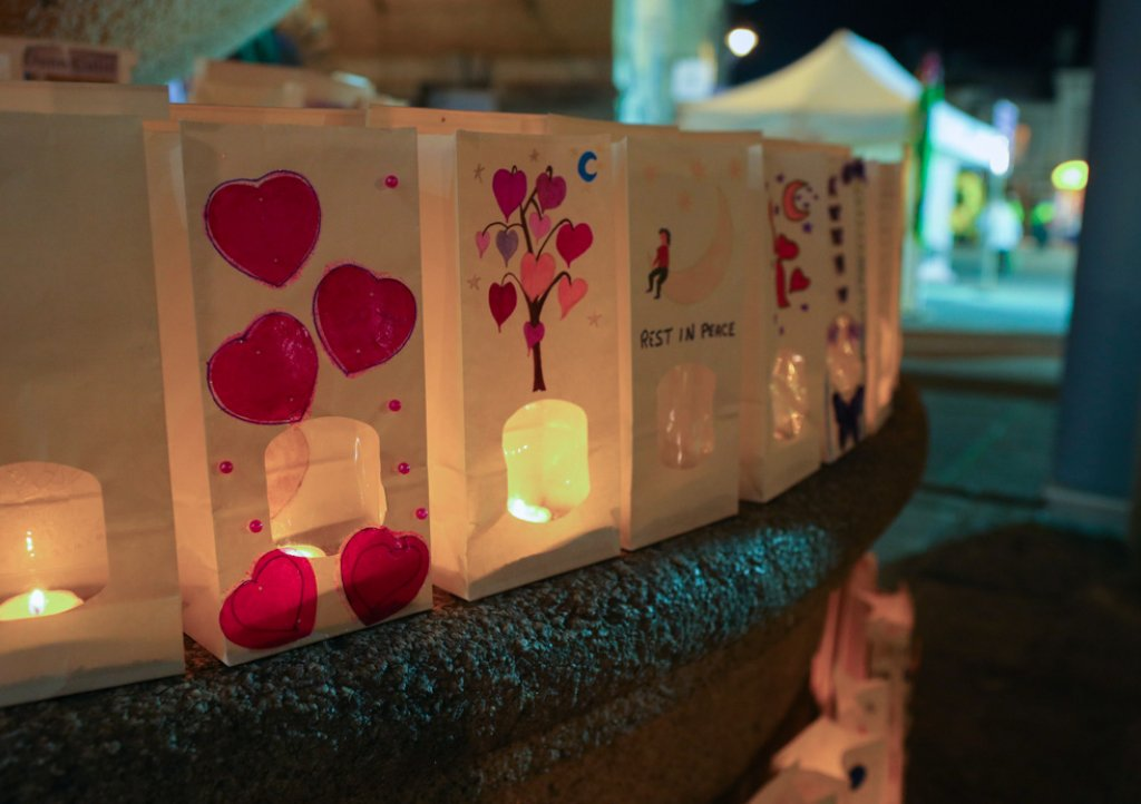 Memory bags lit with a tea light decorated in memory of loved ones