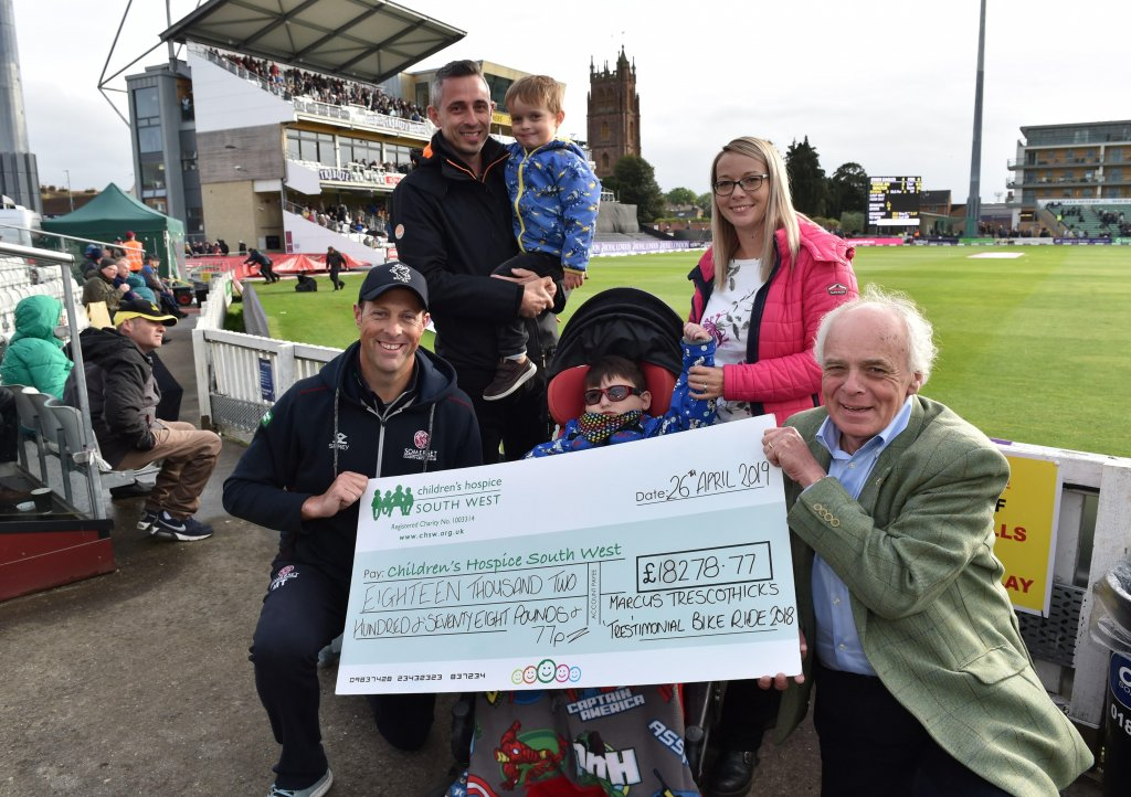 Kevin Morris, Finley's mum Louise Jackson and Finley's little brother Jett join Marcus Trescothick to present the cheque to CHSW chief executive and founder Eddie Farwell. Picture: Geoff Roberts