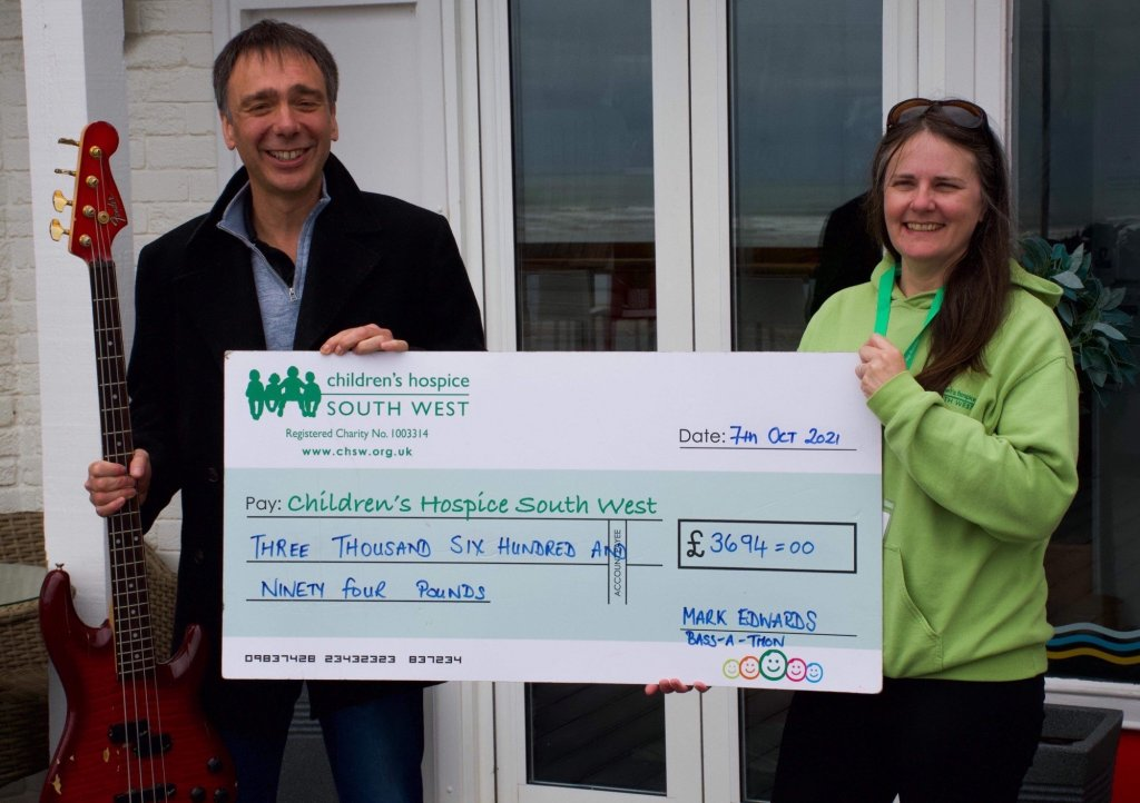 Mark Edwards presents his fundraising cheque to CHSW area fundraiser Ruth Morgan. Picture: Kevin Green