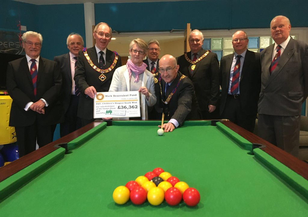 Peter Balsom and members of the Mark Master Masons of Devonshire officially open the new-look games room at Little Bridge House with CHSW Chief Executive Eddie Farwell and Head of Care Tracy Freame