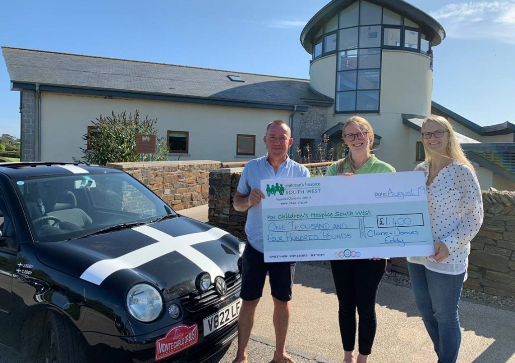Clare and James handover their donation to Alice at Little Harbour