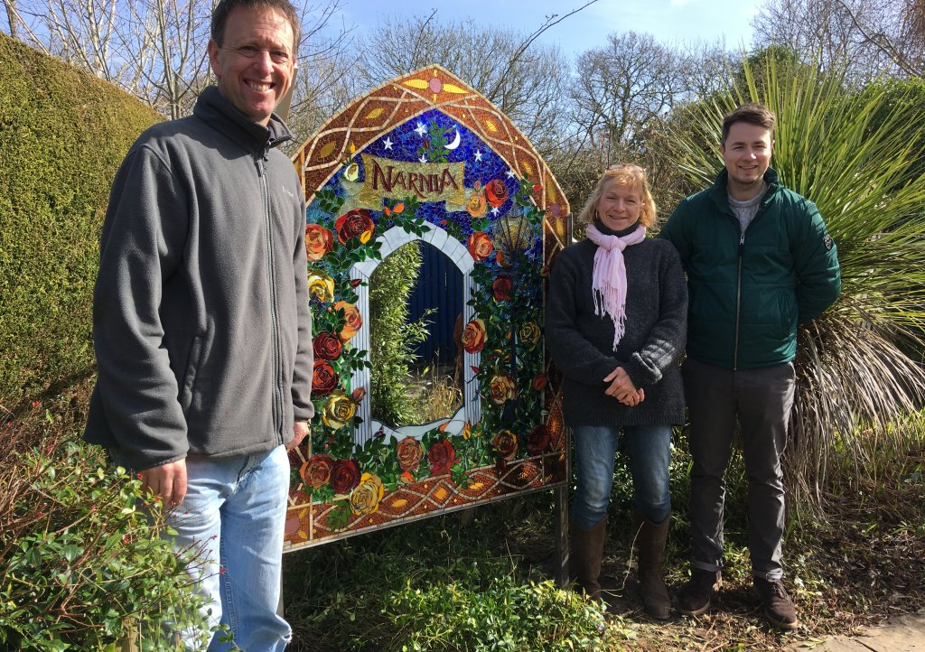 Little Bridge House Maintenance Manager Gary Hatch and Community Fundraiser Josh Allen unveil the new mirror with artist Sue Smith