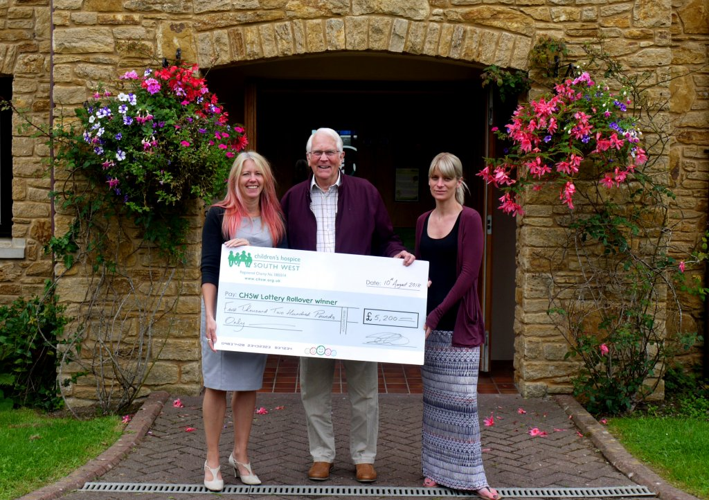 Norman-collects-cheque-from-Little-Bridge-House