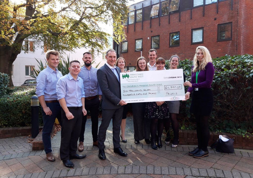 Compliance director Paul White and the Prydis team present their fundraising cheque to Children's Hospice South West Corporate Partnerships Fundraiser Mhairi Bass-Carruthers