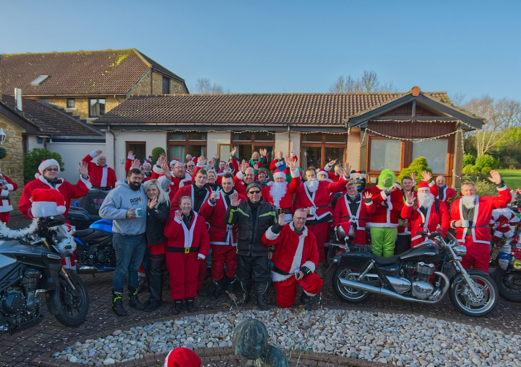 Motorbiking Santas arrive at Little Bridge House. Picture by Will Badman Photography.