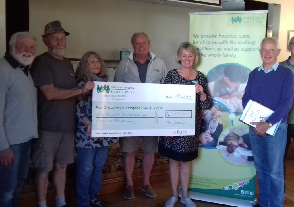 The Jurassix band members present CHSW with a cheque