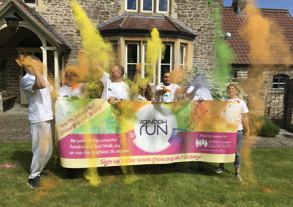 Sponsors-throwing-paint-with-banner-at-Charlton Farm