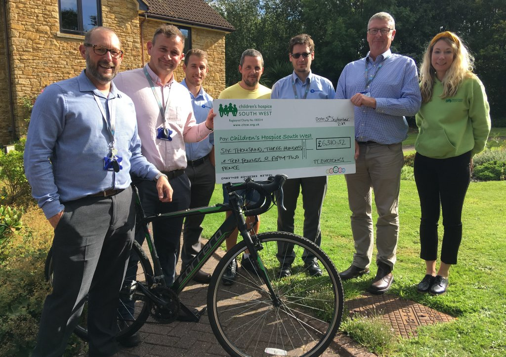 The TT Electronics (from left) Shane Rice, Matt Green, Ben Morris, Kieran Hodge, Mark Lobato and Mark Chatburn present their fundraising cheque to CHSW corporate partnerships fundraiser Mhairi Bass-Carruthers