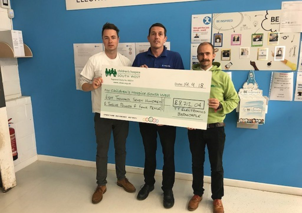 Jason Legg of Aero Stanrew presents a cheque for £8,712.04 to Children's Hospice South West fundraisers Josh Allen and Dominic Scotting