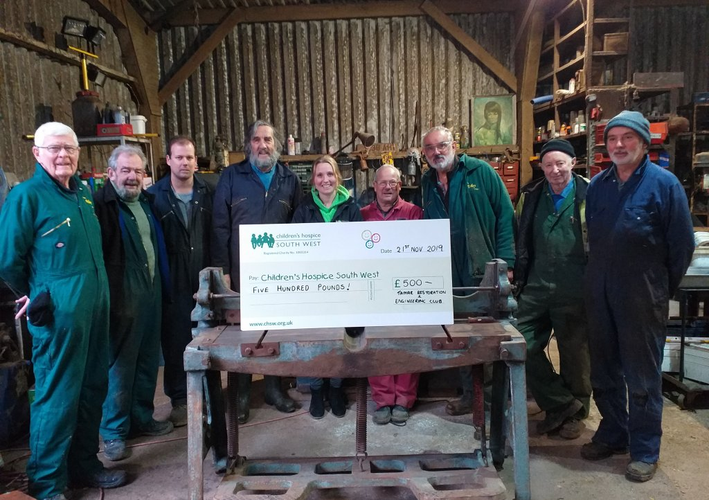 Members of Tamar Restoration and Engineering Club hand over their donation to Zoe from CHSW