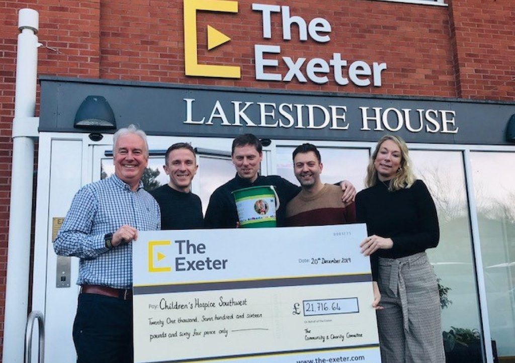The Exeter Chief Executive Andy Chapman and Community and Charity Committee members Ryan Tumulty, Mark Crossley-May and Lee Crichard present the 2019 fundraising total to CHSW Corporate Partnerships Fundraiser Mhairi Bass-Carruthers.