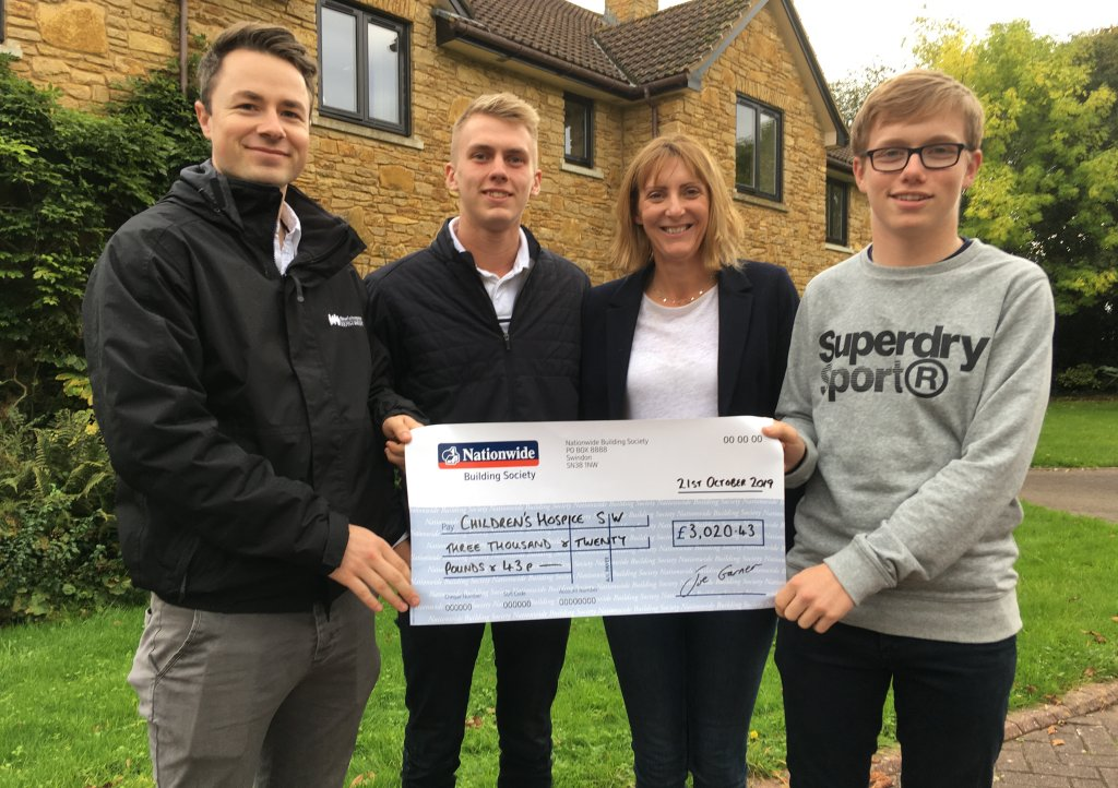 Joe Pike, mum Beverley and new junior captain Sam Pryce present the fundraising cheque to CHSW community fundraiser Josh Allan