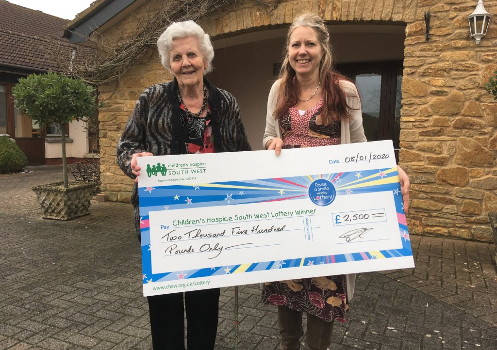 Yvonne Scott receives her Christmas Raffle winner's cheque from CHSW Lottery Manager Stephanie Charles