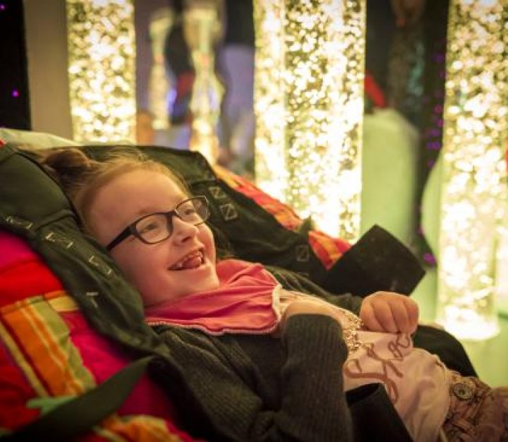 girl smiling in sensory room