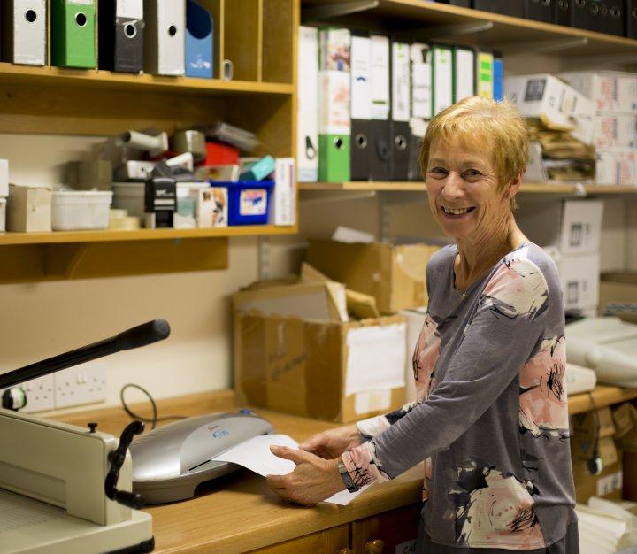 Office volunteer smiling