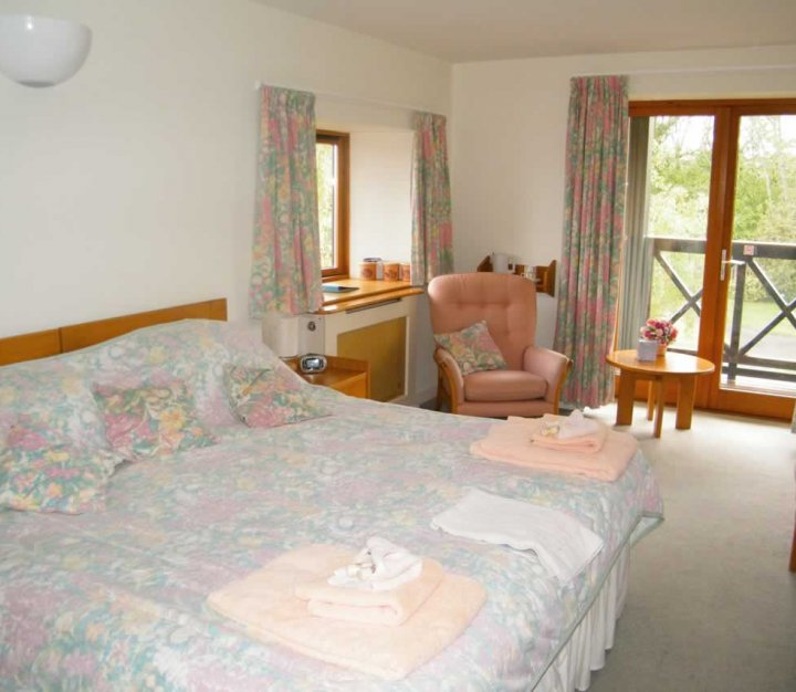 Family accommodation - bedroom at Little Bridge House