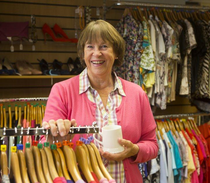 Smiling shop volunteer