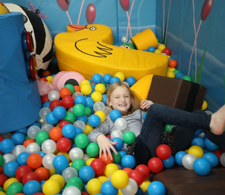 Girl playing in ball pit
