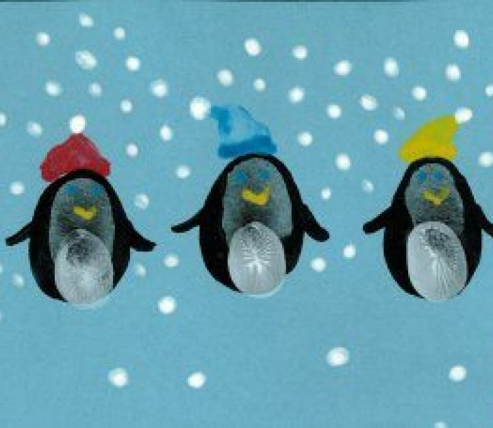 Christmas penguins painted in messy play